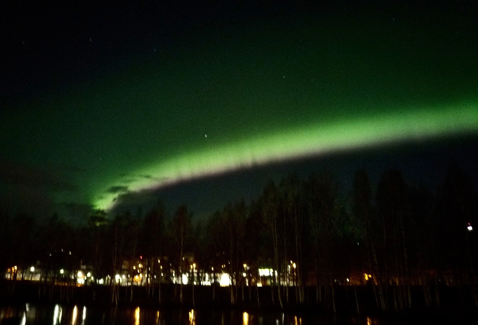 A blurry and crappy photo of northern lights. But hey, it was taken by me, from my backyard!